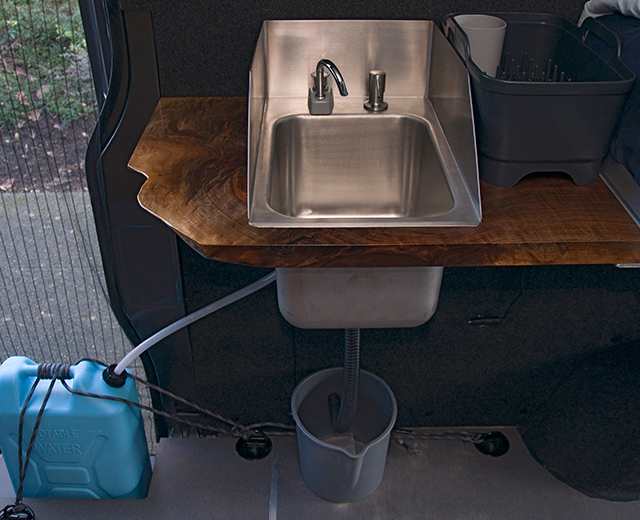 Sink with drying rack and hand pump from jerry can